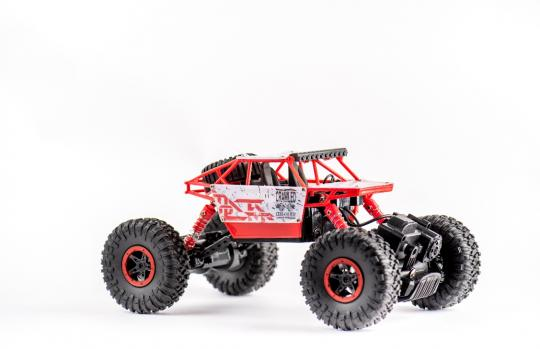Машинка XIANGDIJIA на дистанционном управлении (4WD)(красный цвет)